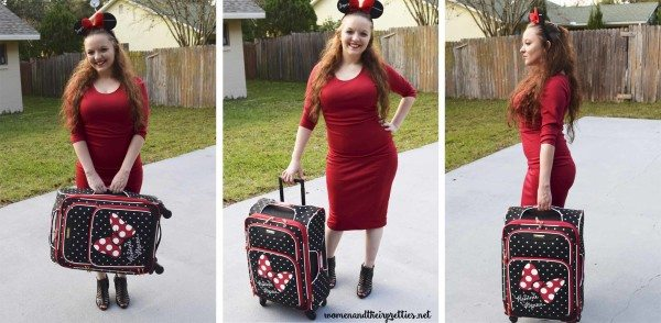 Holding American Tourister Luggage