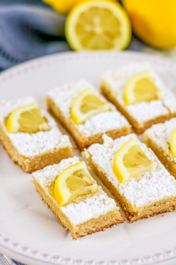 Keto Lemon Bars are a great way to treat the whole family without worrying about the repercussions. These dessert bars are great for anyone living on a low-carb or Keto Diet. #KetoDesserts #LowCarbDesserets