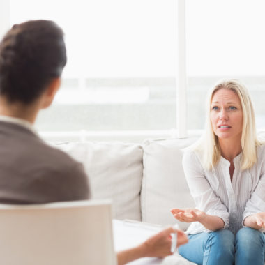 Woman asking questions to therapist
