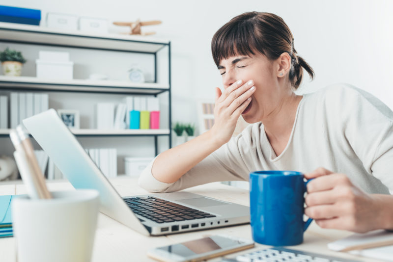 Woman bored at home on computer