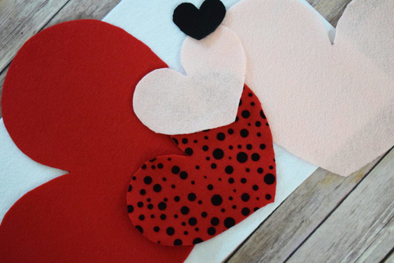 Cupid's Shot at Love is a DIY Valentine's Day game for kids (or adults) of any age to play! It's a cheap and easy to make Valentine's Day craft!